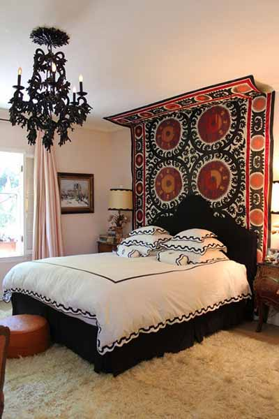 ... building your own headboard, get textiles! They can transform your room  instantly. All you have to do is get a textile and a rod to hang it on the  wall.
